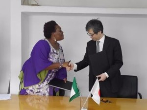 Pamela Braide, a director of KIND receiving the Project Contract from Head of Japanese Embassy